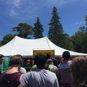 Photo of a line up of people waiting to receive food at the festival of india food tent