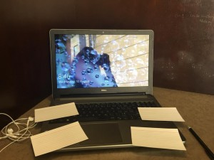 A picture of my laptop with index cards around it for notes and prompts