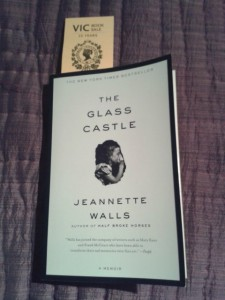 "Photograph of the novel ""The Glass Castle"" with a Victoria College book sale bookmark sticking out of the book"