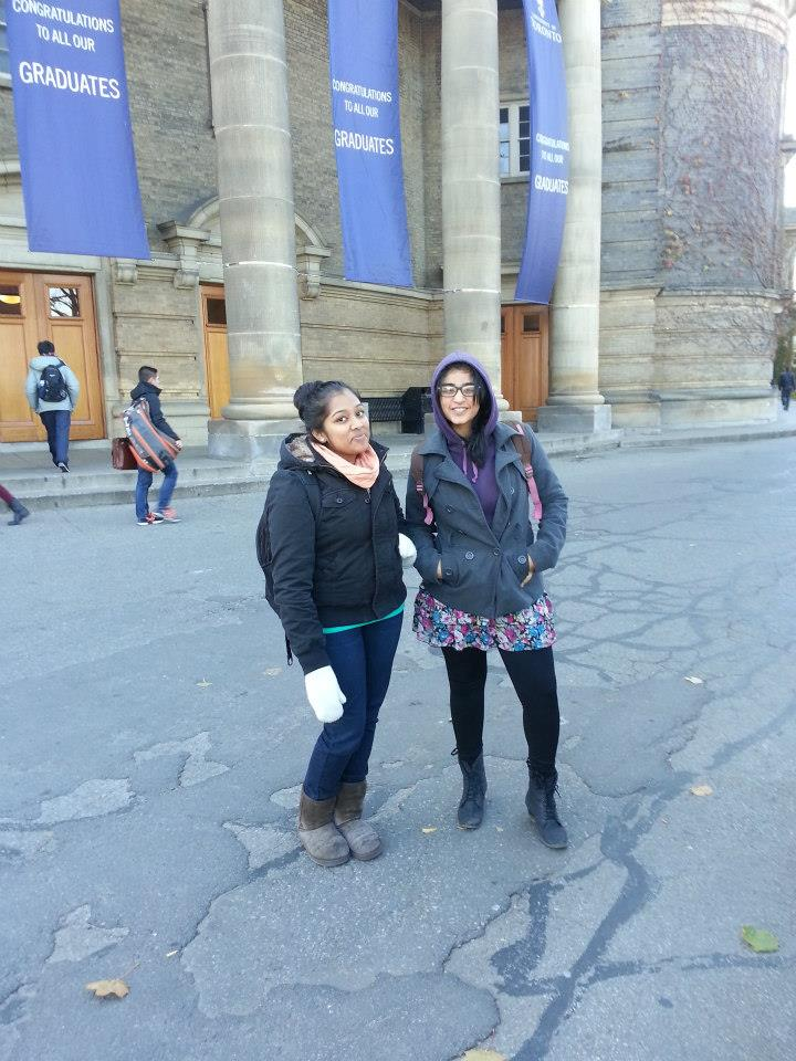 Sargam and a friend standing in front of Con Hall UofT