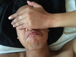 a photo of the blogger Jasper's head lying in bed with his hand covering his eyes donning a frowning expression