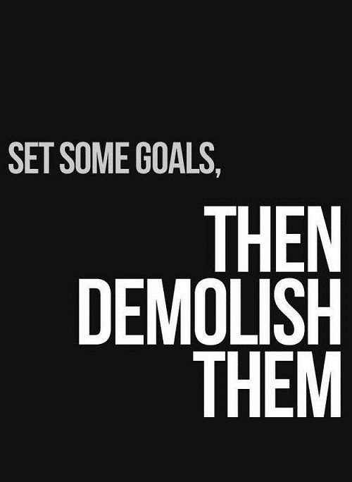 "White and grey text on a black background reads ""Set some goals, then demolish them."""