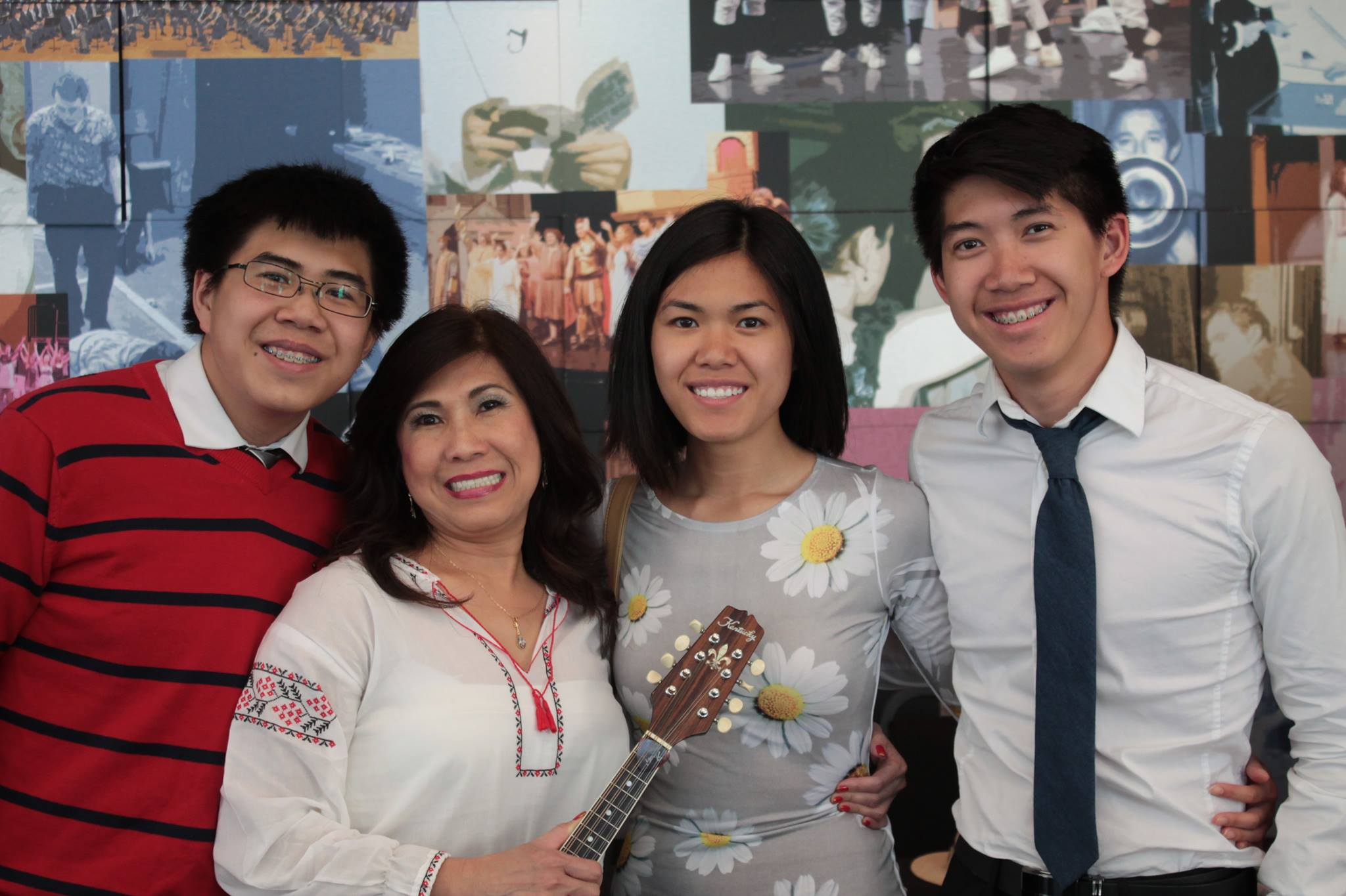 """ALT=""""A photo of me standing with my family at my mom's mandolin recital."""""""