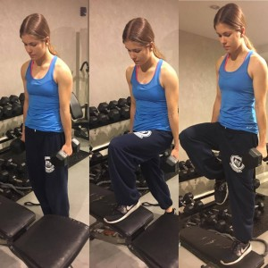 Annette demonstrates dumbbell step ups, she steps onto a bench with a dumbbell in each hand.