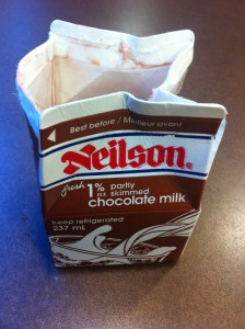 A picture of a small milk carton, with a large opening, because I opened it the wrong way.