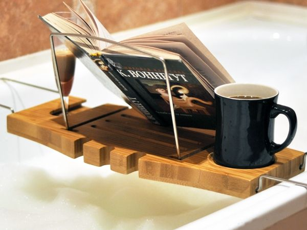 Book and mug on bathtub tray