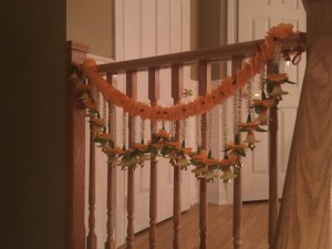 A streamer made of flowers and bells to emulate Indian household decor