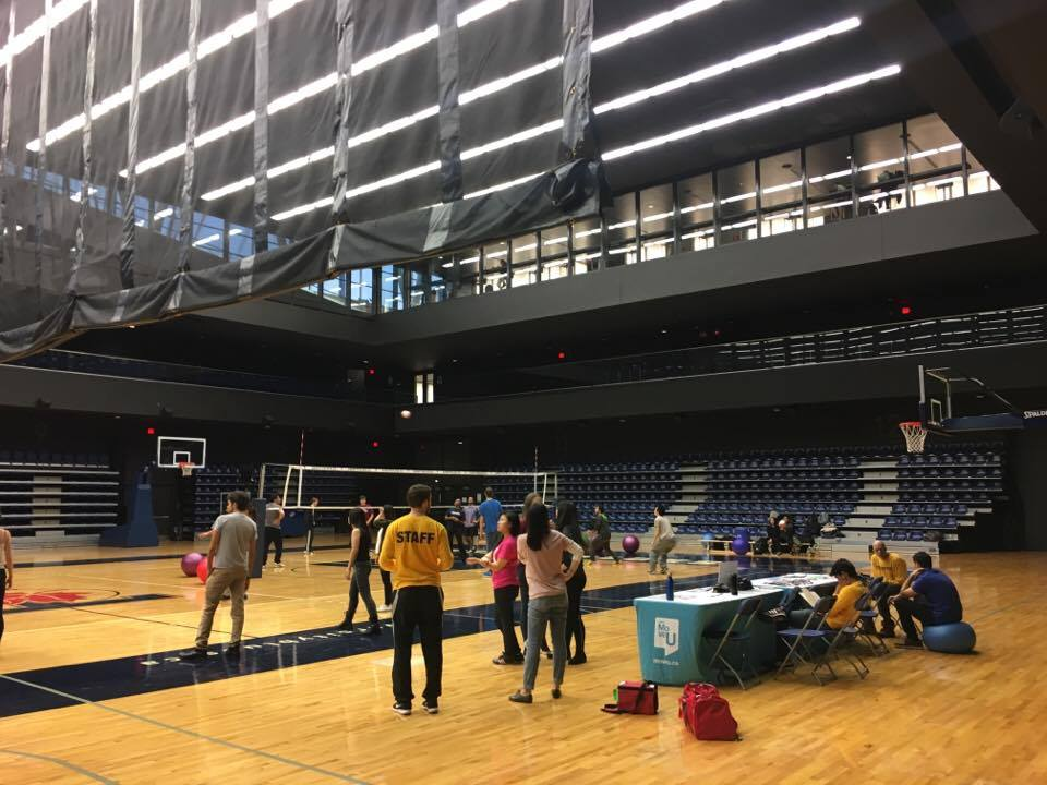 The Goldring Centre Field House is shown with participants gathered to play balley ball.