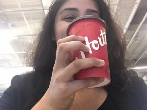 Tim Hortons cup in Sargam's hand