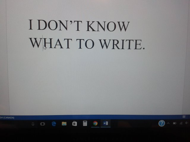 "Photograph of computer screen with the words ""I don't know what to write"" written on Microsoft Word"