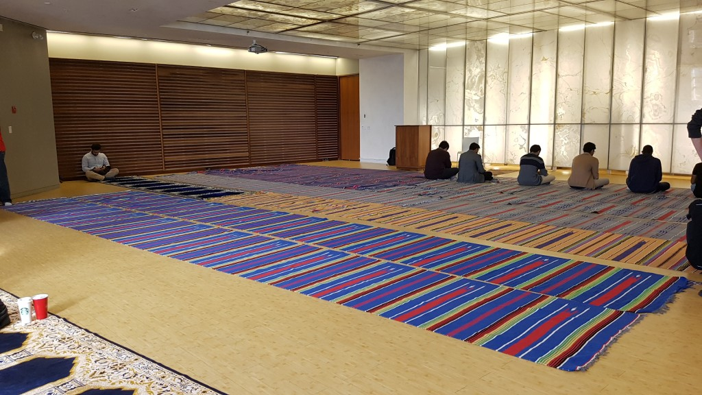 Multi-Faith Centre room being used as a Muslim prayer room, rugs laid on the floor.