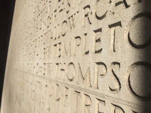 a photo of engraved names on a memorial wall of fallen soldiers of world war 1 and world war 2