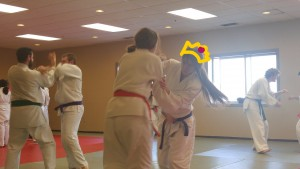 Annette is shown participating in Jiu Jitsu with a crown drawn over the photo.