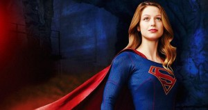 A photo of supergirl with her cape in the wind.