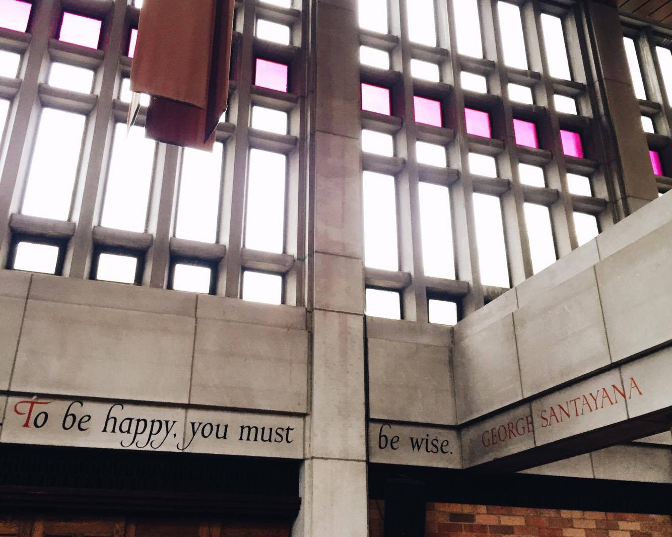 "ALT=""A building with the phrase [To be happy you must be wise] carved into stone"""