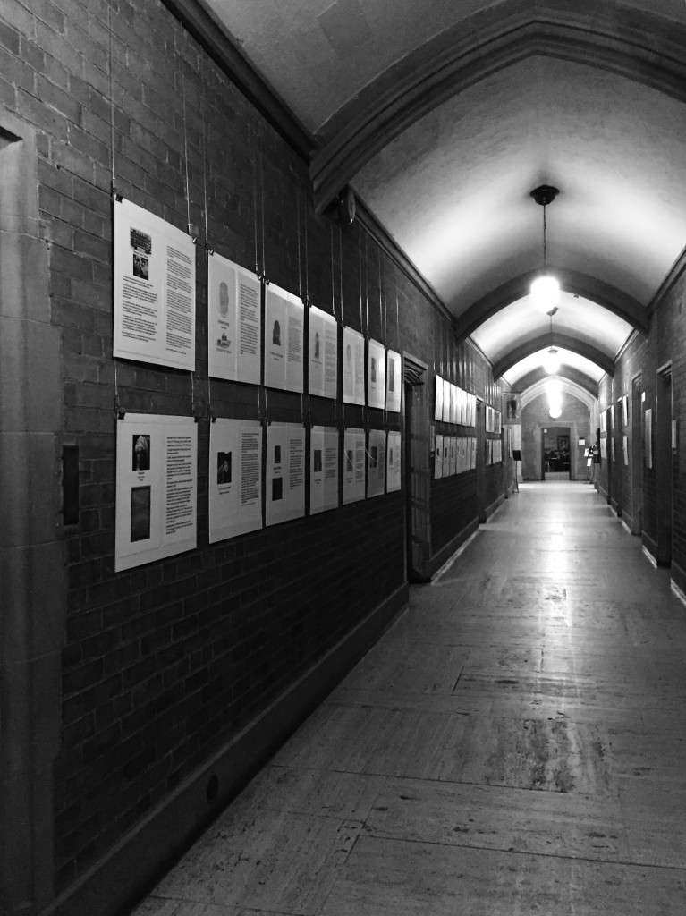 Exhibit panels showcased on the walls of the Main Hall at Hart House