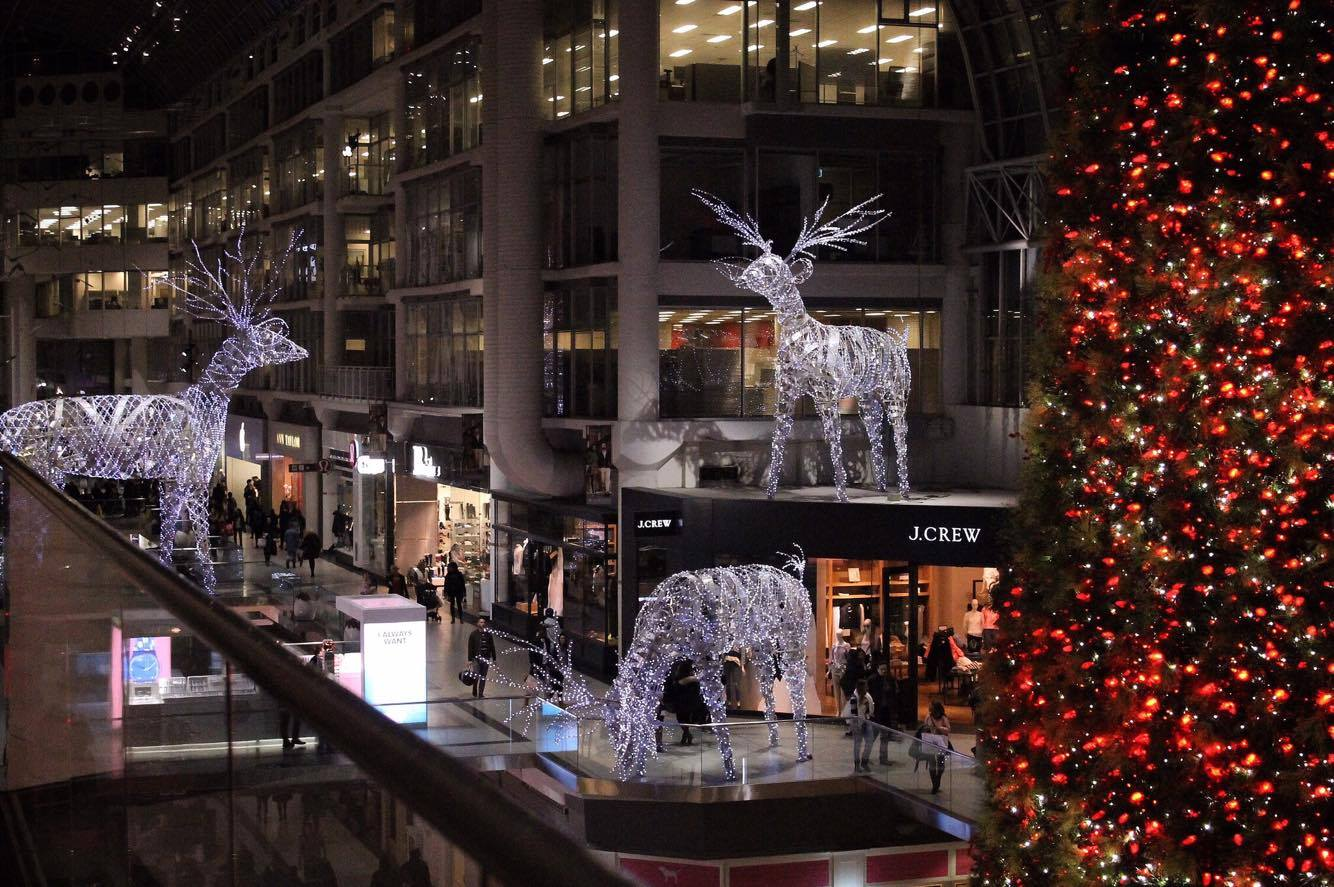 An image of the Eaton Center during the winter holiday season - there are 3 giant reindeer made from LED lights