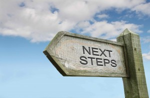"Picture of a road sign that says ""next steps"""