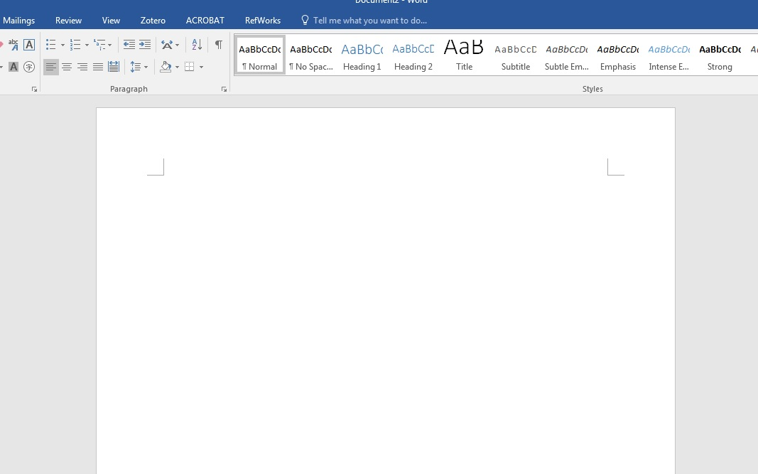 an image of a document spreadsheet that is empty with the microsoft word toolbar along the top and the blue border of the window title at the very top of the image
