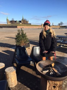 I warm up at the fire next to the harbour in Helsingør, Kronborg castle is in the background.