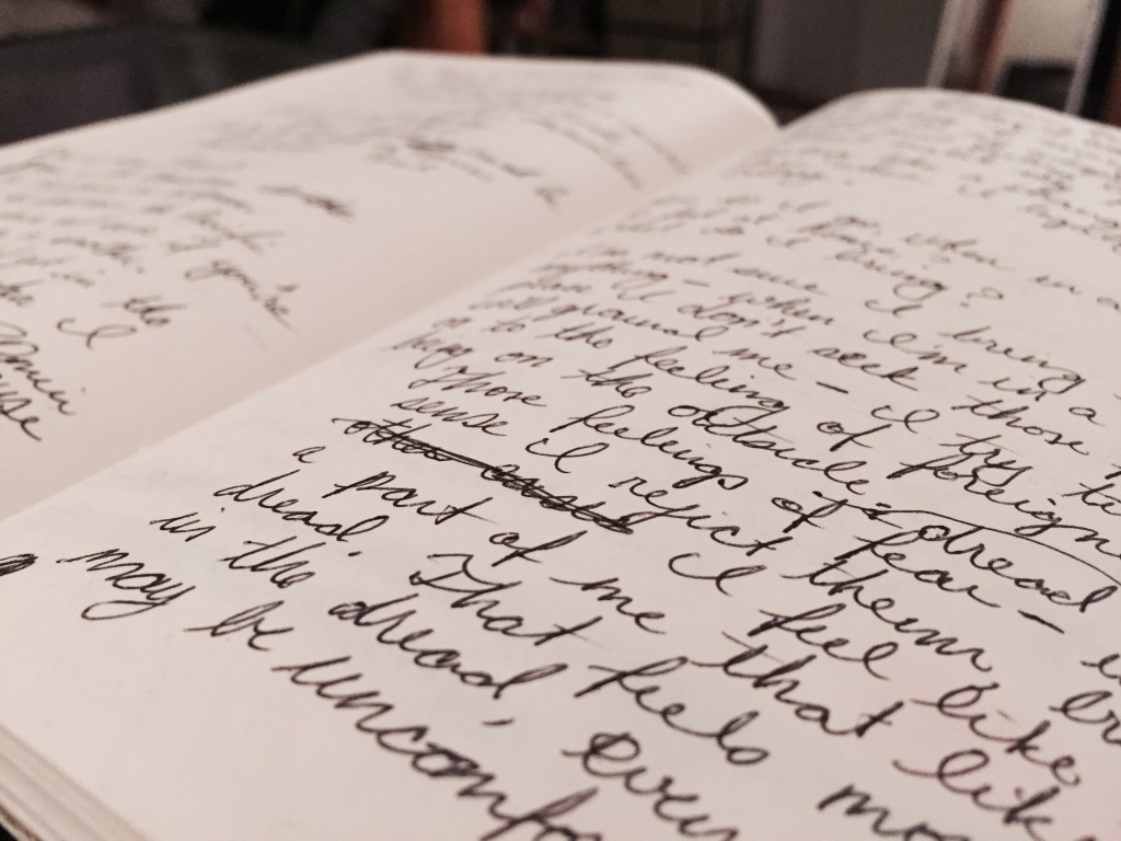 A journal open to two pages filled with writing