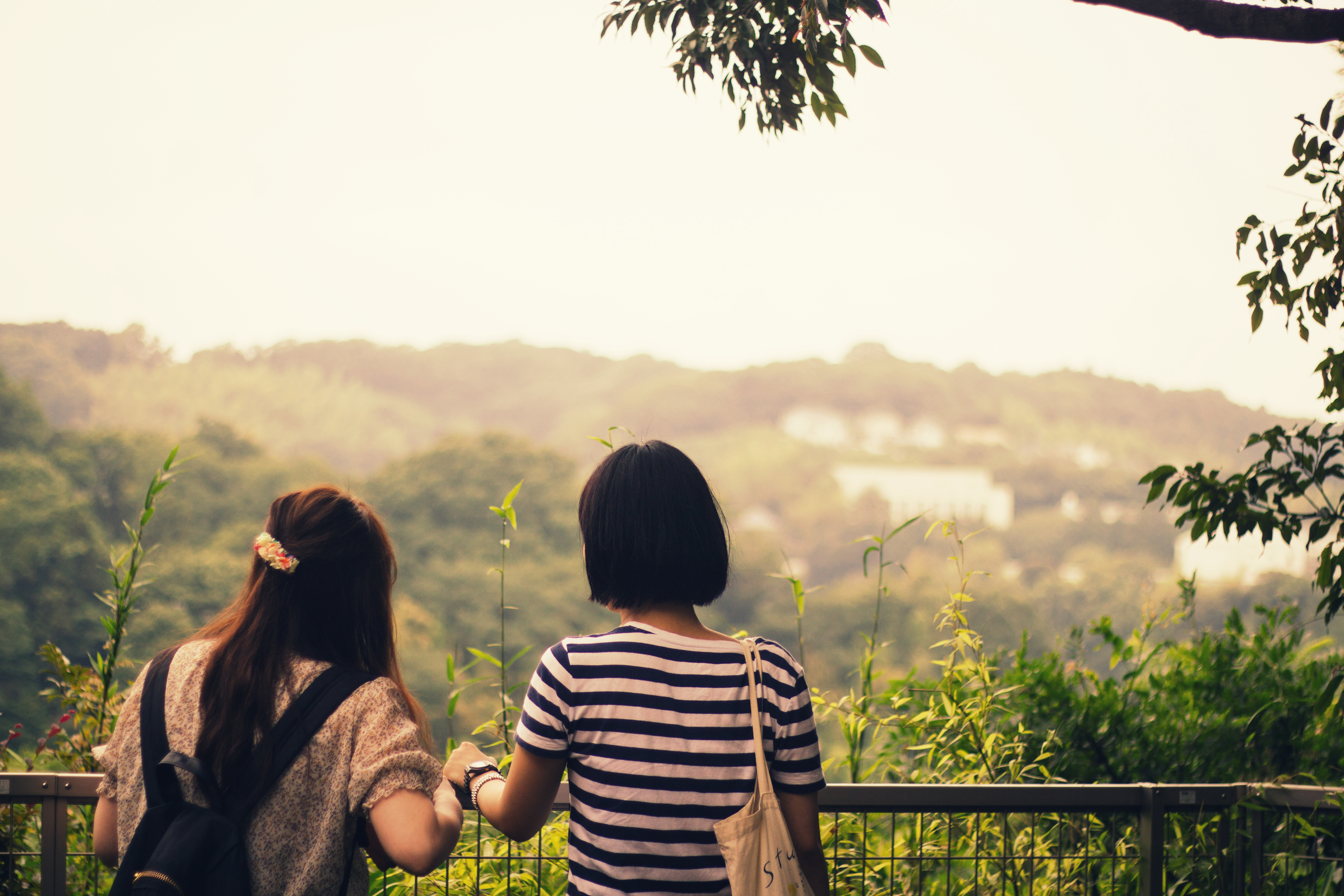 Two girls overlooking the hillside in Kamakura, Japan.