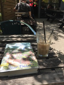 Picture of book and iced coffee on a table
