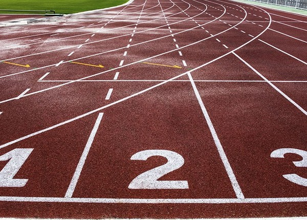 A picture of a race track and field race track