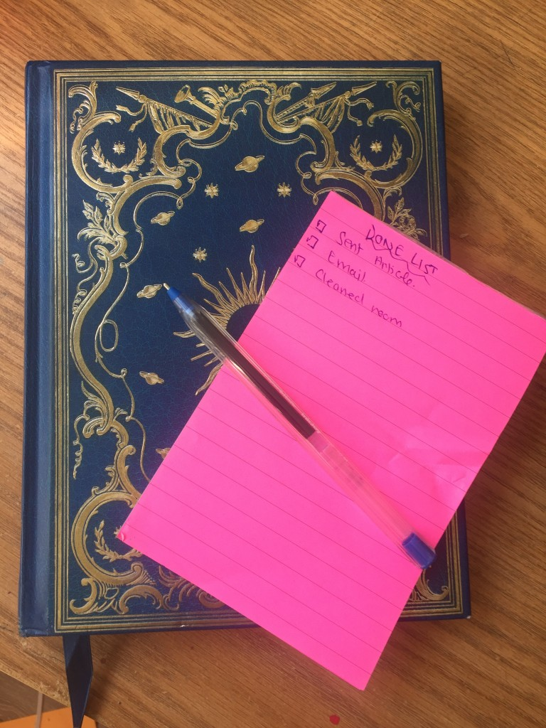A picture of a note book and list of completed tasks.