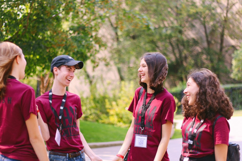 A group of four Victoria College freshmen, talking and laughing.