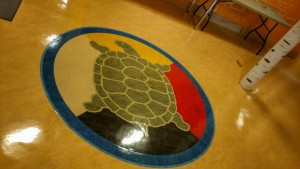 A photo pf Turtle Lounge logo with traditional medicine wheel and turtle