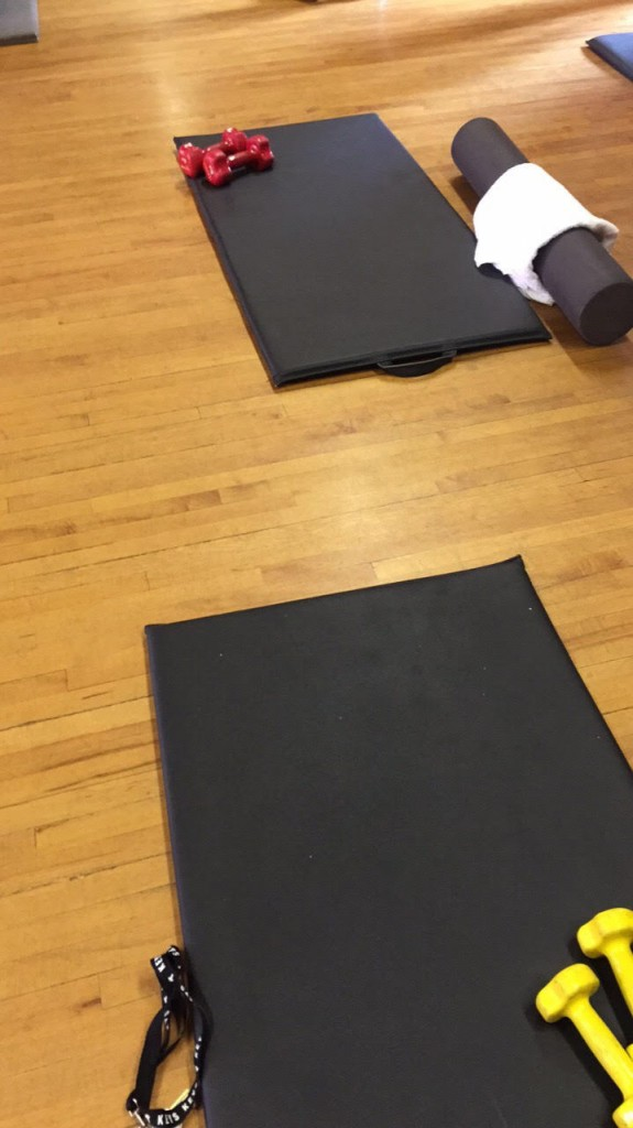 A picture of exercise mats and weights.