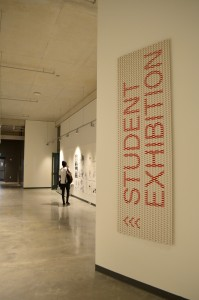 white sign with 'STUDENT EXHIBITION' written in red
