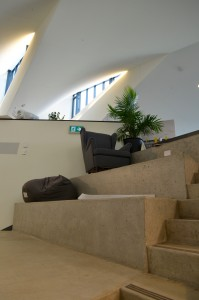 large stairs on 3rd floor with sofas and bean bags on them
