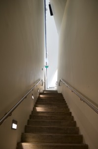 view of narrow stairs connecting 1st floor to 3rd