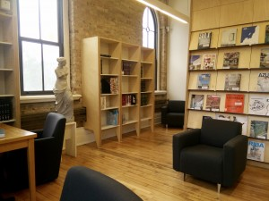 a warm toned library with sofas at Daniels