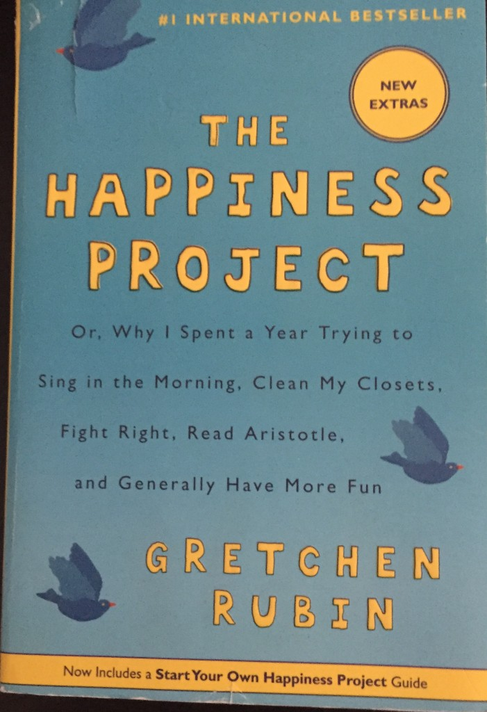 Book cover of The Happiness Project by Gretchen Rubin.