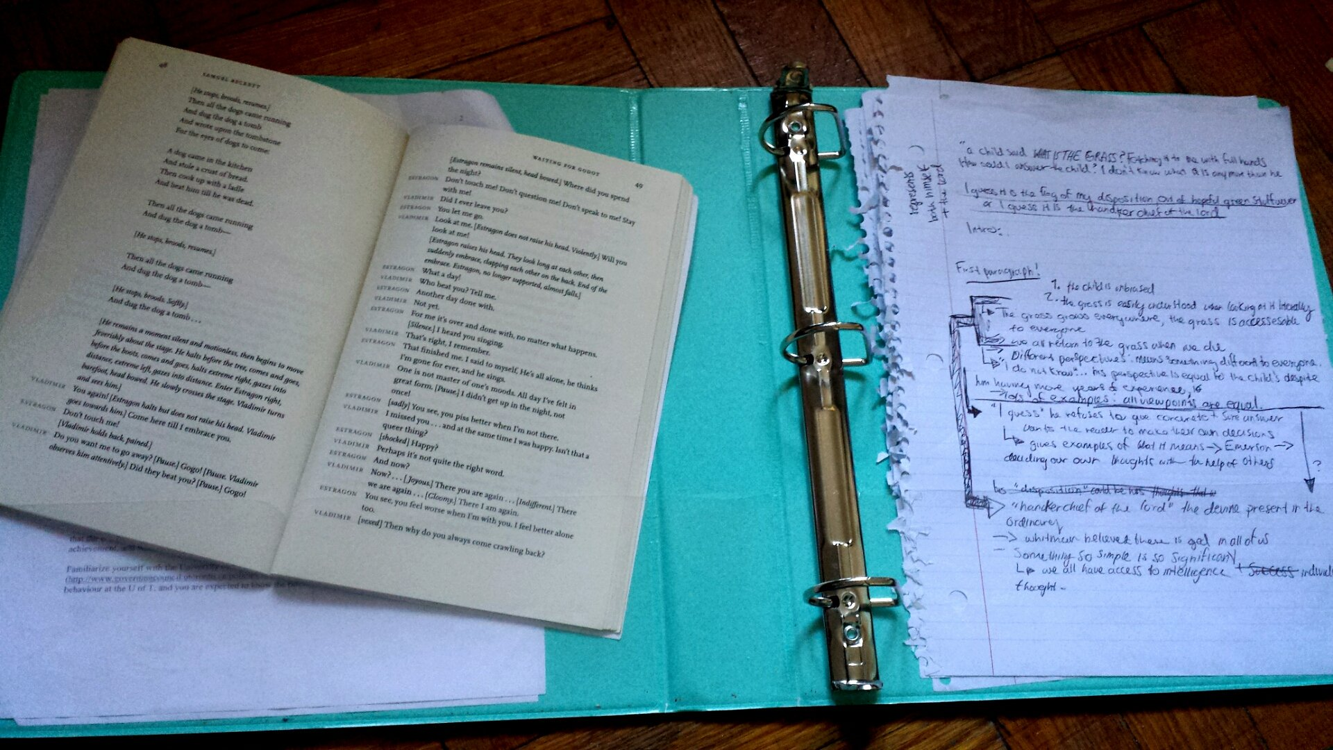a collection of papers littered with black handwriting, next to an open playbook-both resting atop a bright blue binder