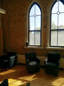 A picture of big windows and sofas in the new library at Daniels