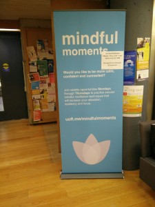 large blue banner of mindful moments in Wilson Hall, New College