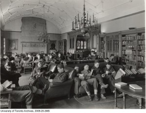 an old picture of hart house library with students in uniform sitting