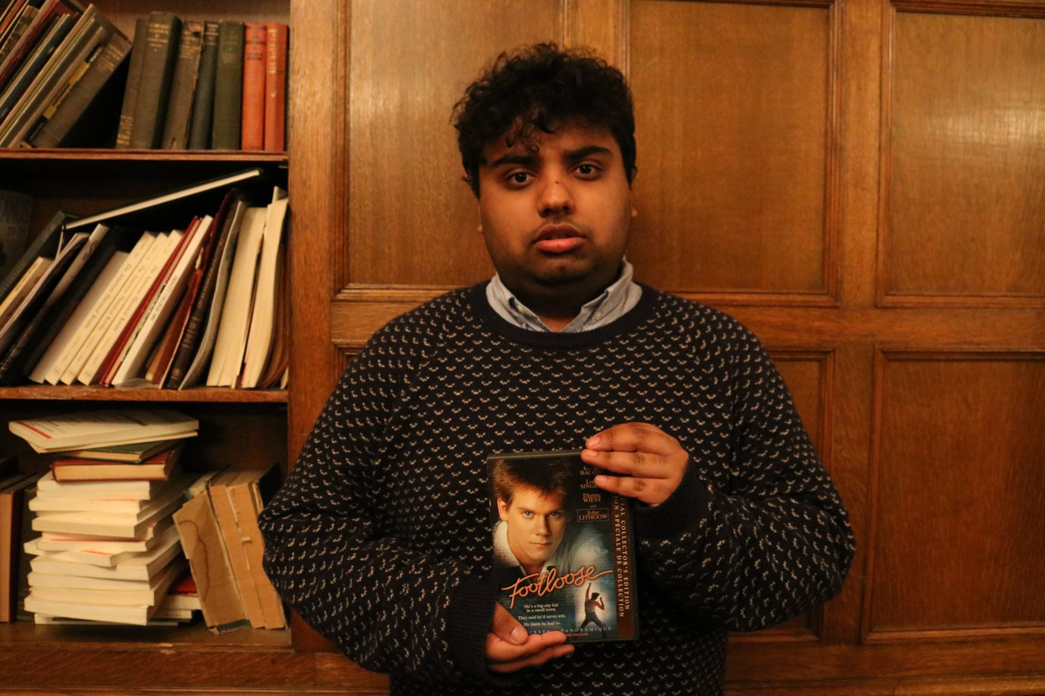 Picture of Avneet holding a DVD copy of Footloose