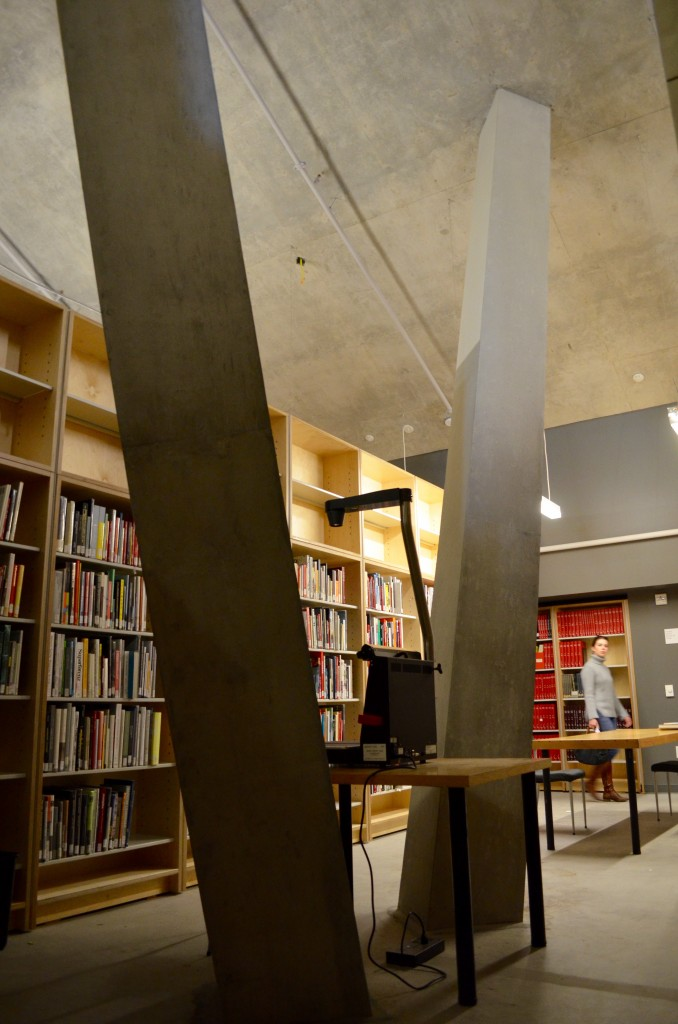 The basement level of Daniels library with two huge concrete pillars