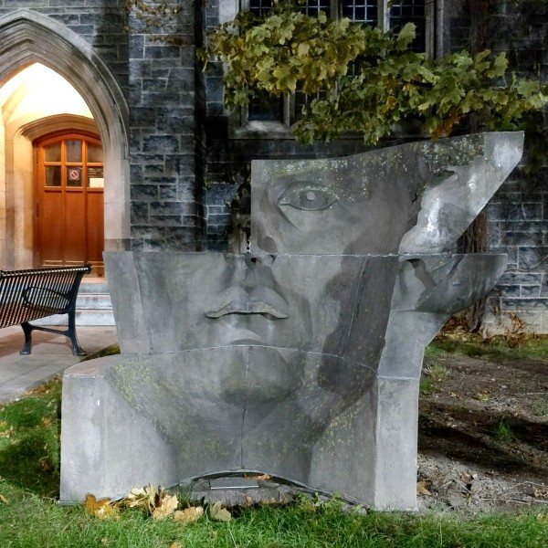 picture of the Hart House Mask sculpture which looks like a changing face from each side