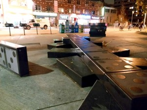 picture of the black domino-benches on the corner of Bloor and Spadina