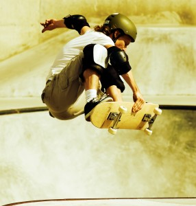 A skateboarder doing a jump on a ramp.