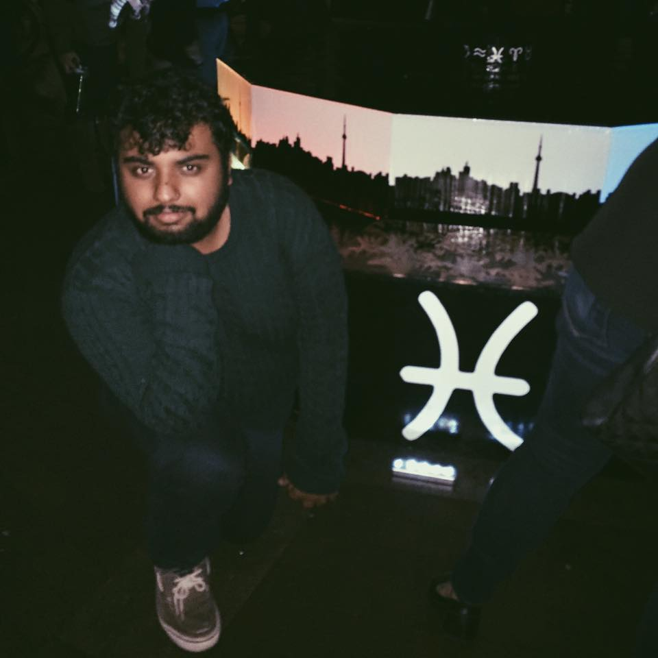 Picture of Avneet posing next to the Pisces symbol.