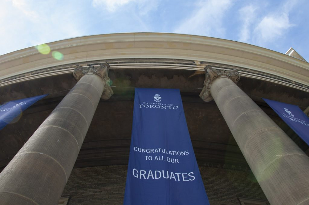 picture looking up at convocation hall with a blue U of T banner saying