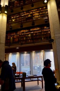 Picture of the large window below bookshelves in the Thomas Fisher Rare Book Library