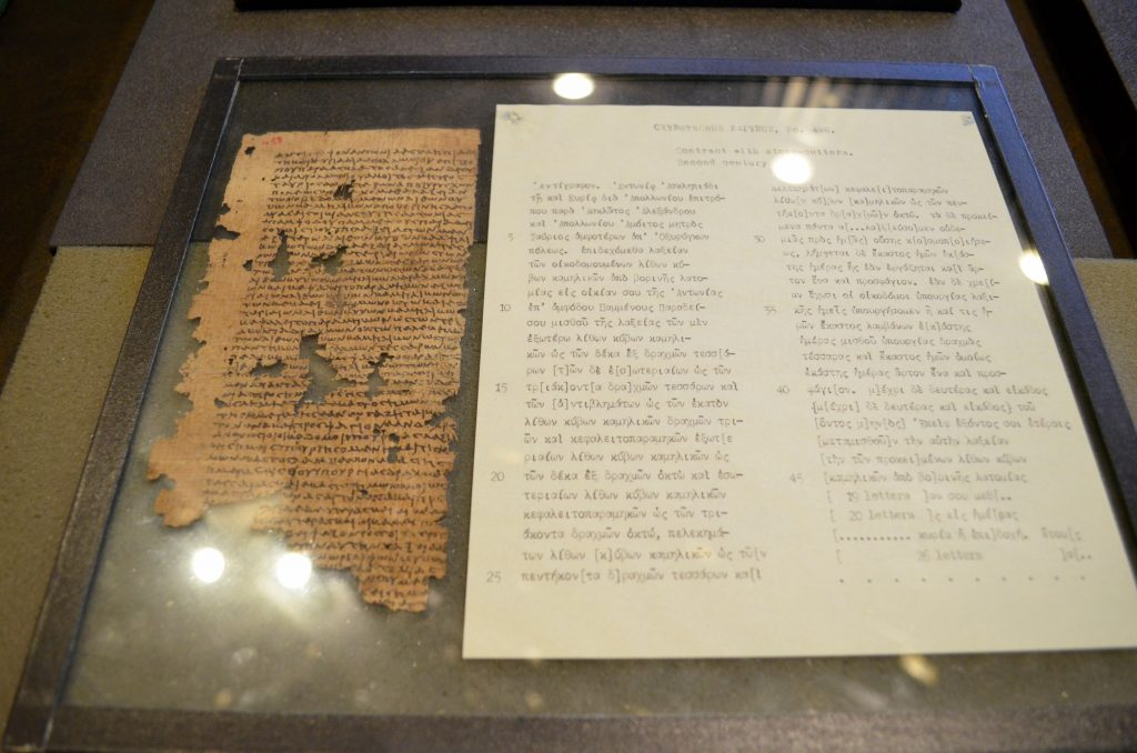 picture of a contract with stonecutters written on papyrus from ancient Egypt - held in a glass casing